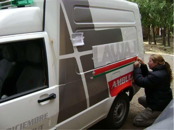 RA Trabajando - Retirando transfer - Ambulancia - Cholila - Provincia del Chubut - RA Carteles